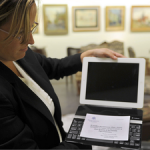 The-winning-bidder-took-home-the-tablet-a-keyboard-and-a-certificate-from-the-Popes-personal-secretary